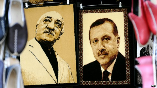 Carpets printed with the faces of Gulen and Erdogan hanging in a market, 17 Jan 2014.
