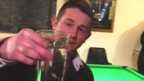 Paul Wooding brandishing a glass with minnows in it