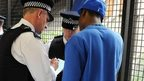 Police officers conduct a stop and search