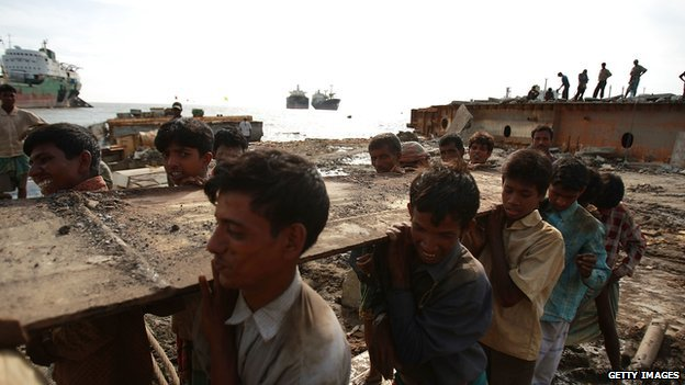 Workers breaking up a ship in the port city of Chittagong, Bangladesh