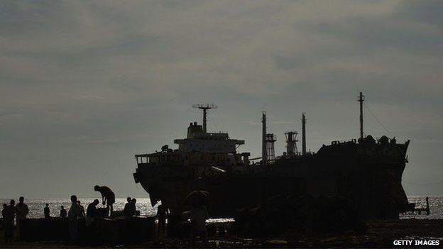 A ship is dismantled for scrap in the port city of Chittagong, Bangladesh