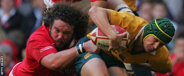 Adam Jones tackles Australia's Matt Giteau in 2006
