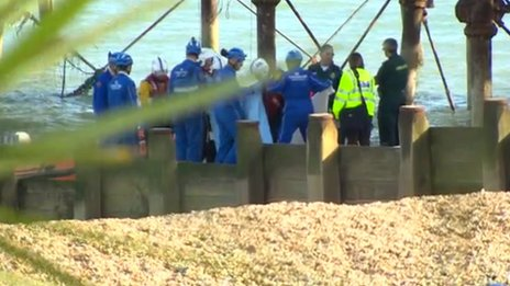Emergency services on Eastbourne beach after man fell from pier