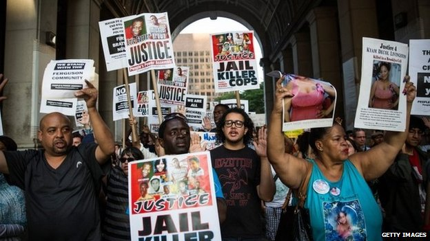 Protesters hold a rally in solidarity with the people in Ferguson, Missouri protesting the death of Michael Brown and the excessive use of force by police in New York City 18 August 2014