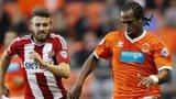 Brentford's match-winner Stuart Dallas and Blackpool goalscorer Nathan Delfouneso