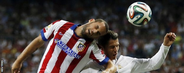 Cristiano Ronaldo and Atletico Madrid's Mario Suarez