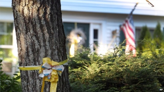 A ribbon is tied to a tree outside the home of James Foley in Rochester, New Hampshire. Photo: 19 August 2014