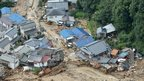 Houses heavily damaged after a massive landslide swept through residential areas in Hiroshima, western Japan, on 20 August 2014