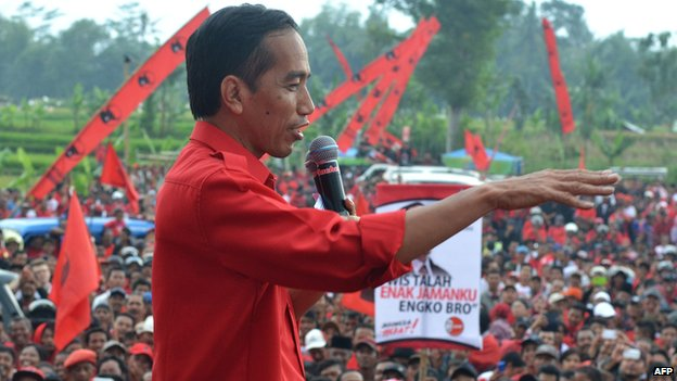 Then-Jakarta Governor Joko Widodo, delivers a speech as he campaigns ahead of legislative elections in Malang on 30 March, 2014