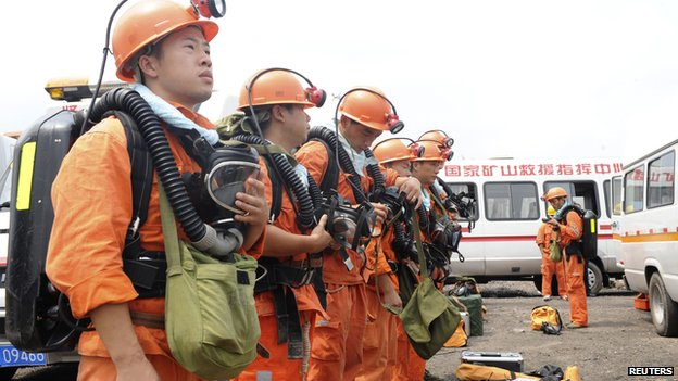 Rescuers prepare their equipment before going down a coal mine to carry out rescue operations following an explosion, in Huainan, Anhui province on 19 August, 2014