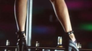 Pole dancer's legs