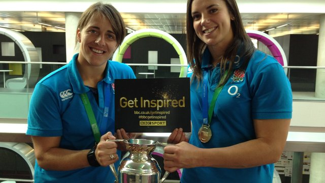 Katy McLean & Sarah Hunter holding the Rugby World Cup