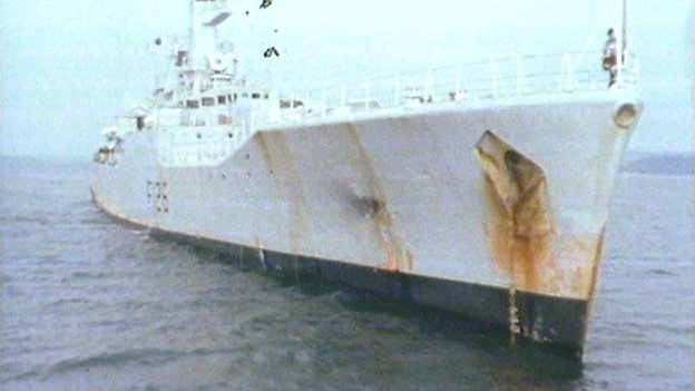 HMS Plymouth showing bomb damage on side of ship
