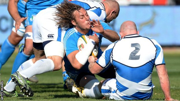 Italy's Josh Furno gets tackled during the Castle Larger Incoming Tour match between Italy and Scotland