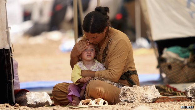 A Yazidi refugee and her child in Syria on August 17