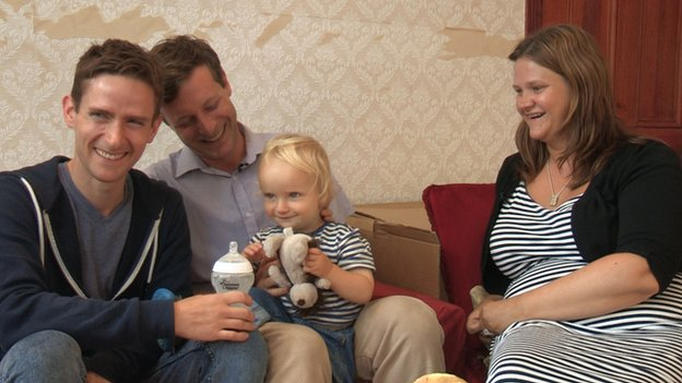 Michael Scott Kline and Nick Scott with surrogate mother Sarah Jones and child Elliot
