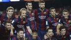 Barcelona players pose for a team photo with the Joan Gamper trophy