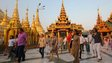 Tourists at walking around the Shwedagon pagoda in Yangon