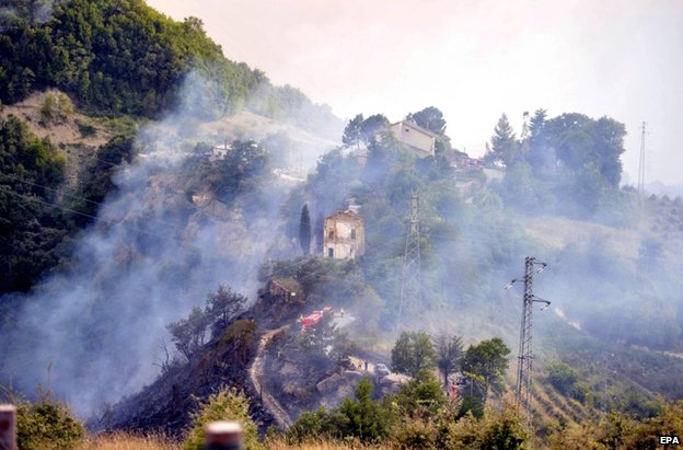 Fire engines near the crash site in the Marche region of eastern Italy, 19 August