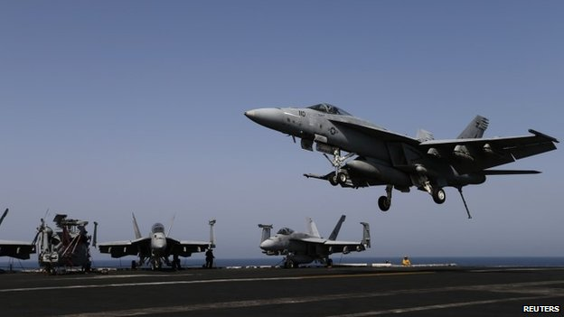 A F/A-18E Super Hornet of Strike Fighter Squadron (VFA-31) comes in to land onboard the flight deck of the aircraft carrier USS George HW Bush (CVN 77), in the Gulf 12 August 2014
