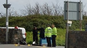 Guernsey Police officers examining crash site at Salerie Corner