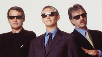 Alan Hansen, Gary Lineker and Mark Lawrensen pose in sunglasses