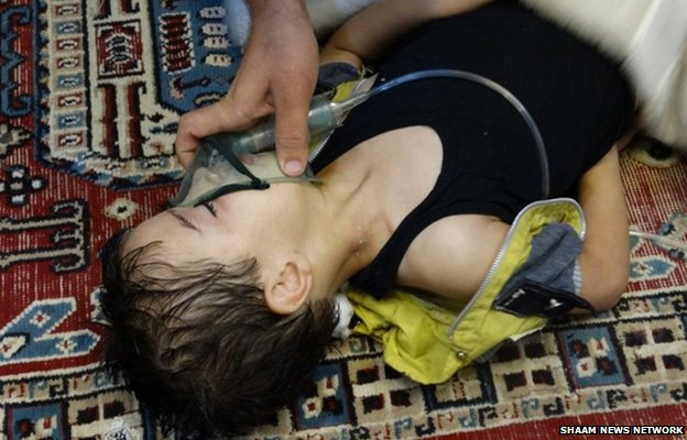 Medic gives oxygen to a boy after the 21 August chemical weapons attack in Damascus
