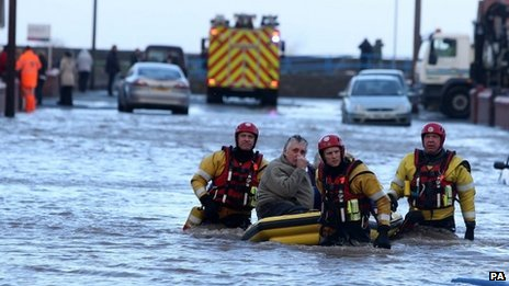 People are rescued by the RNLI from the floods in Rhyl last December