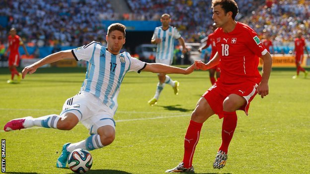 Federico Fernandez tussles with Admir Mehmedi of Switzerland