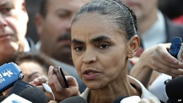 Brazilian Socialist Party (PSB) presidential candidate Marina Silva speaks to the press after attending a Mass in honour of late presidential candidate Eduardo Campos in Brasilia, Tuesday, Aug. 19, 2014.
