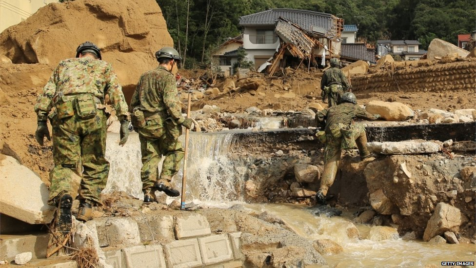 Members of Japan's Ground Self-Defense Force continue the search for missing people among the debris