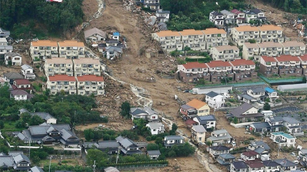 This aerial view shows the damage caused by a landslide after heavy rains hit the city of Hiroshima, western Japan, on 20 August, 2014