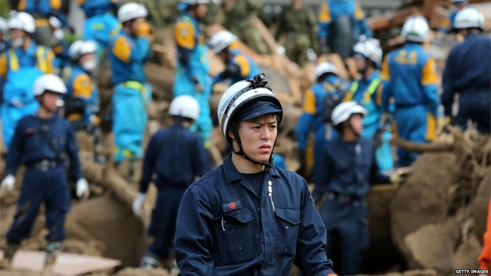 Members of Japan's Ground Self-Defense Force continue the search for missing people among the debris of house destroyed by a landslide caused by torrential rain at the site of a landslide in a residential area on 21 August, 2014 in Hiroshima, Japan
