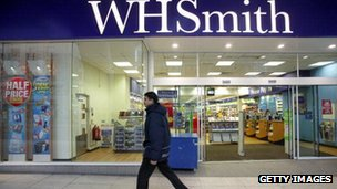 A man walks past a WH Smith store