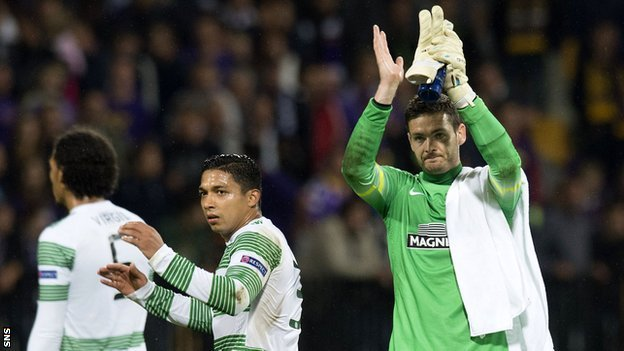 Celtic goalkeeper Craig Gordon salutes the fans following the draw in Slovenia