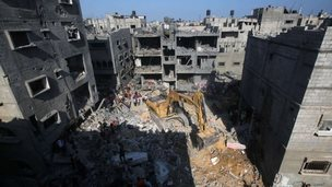 Rubble from the site of an Israeli air strike on Rafah, in the south of the Gaza Strip, 21 August