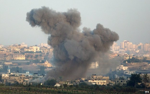 Smoke rises after an Israeli air strike on the northern Gaza Strip, 21 August