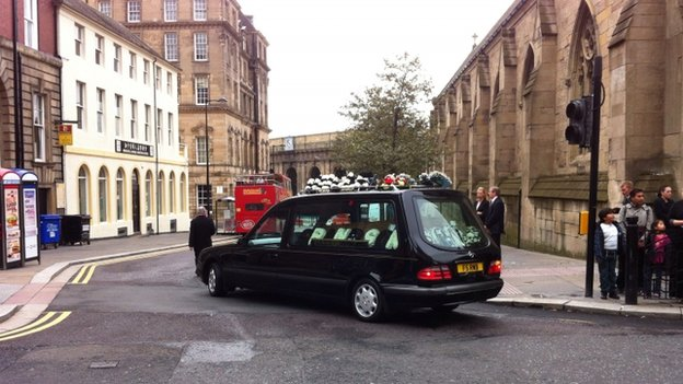 Funeral cortege leaves cathedral