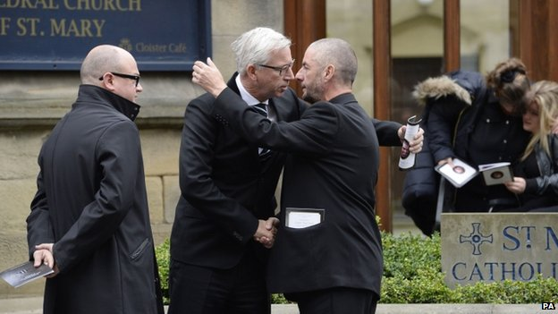 "Barry Sweeney is hugged by Newcastle United manager Alan Pardew outside St Mary""s Cathedral, Newcastle, where the funeral of his son and Flight MH17 victim Liam Sweeney took place"