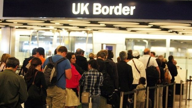 People queuing at the UK border in an airport