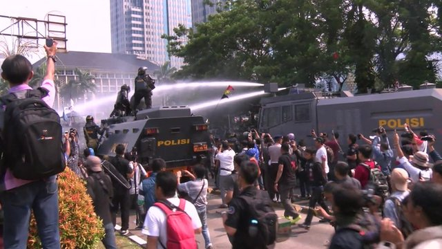 Police fire water cannon