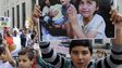 Yazidi children in Angers in western France hold placards in support of their community in Iraq (20 August 2014)
