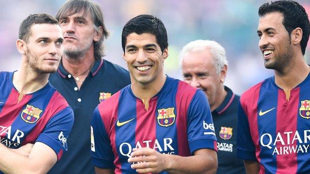 Luis Suarez with team mates Vermaelen