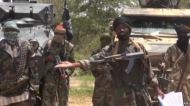 A screengrab taken on 13 July 2014 from a video released by the Nigerian Islamist extremist group Boko Haram and obtained by AFP, showing the Boko Haram leader Abubakar Shekau (C)