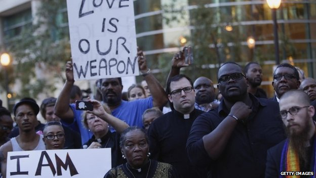 A group of pastors, clergy and protesters stand outside the office building of St. Louis County Prosecutor Bob McCullough on August 20, 2014 in Clayton, Missouri, demanding justice in the police shooting of Michael Brown.