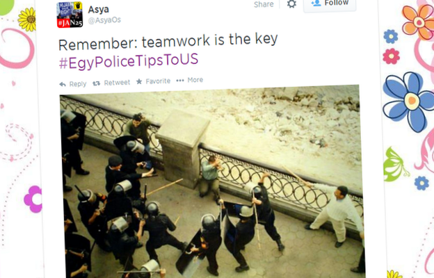 "A tweet showing a group of police beating a man and reading ""Remember: teamwork is the key"""