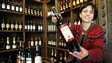 A Georgian woman holding a bottle of the country's wine