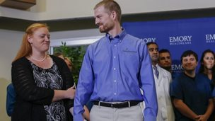 Ebola virus survivor Dr. Kent Brantly (C) and his wife, Amber (L) arrive at news conference at Emory University Hospital in Atlanta, Georgia 21 August 2014