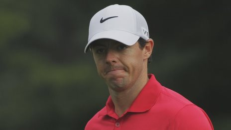 Rory McIlroy shows his frustration after a bad drive at the 12th