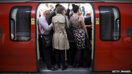 Passengers on a Tube train
